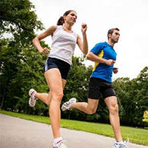 A man and woman going for a run in a park