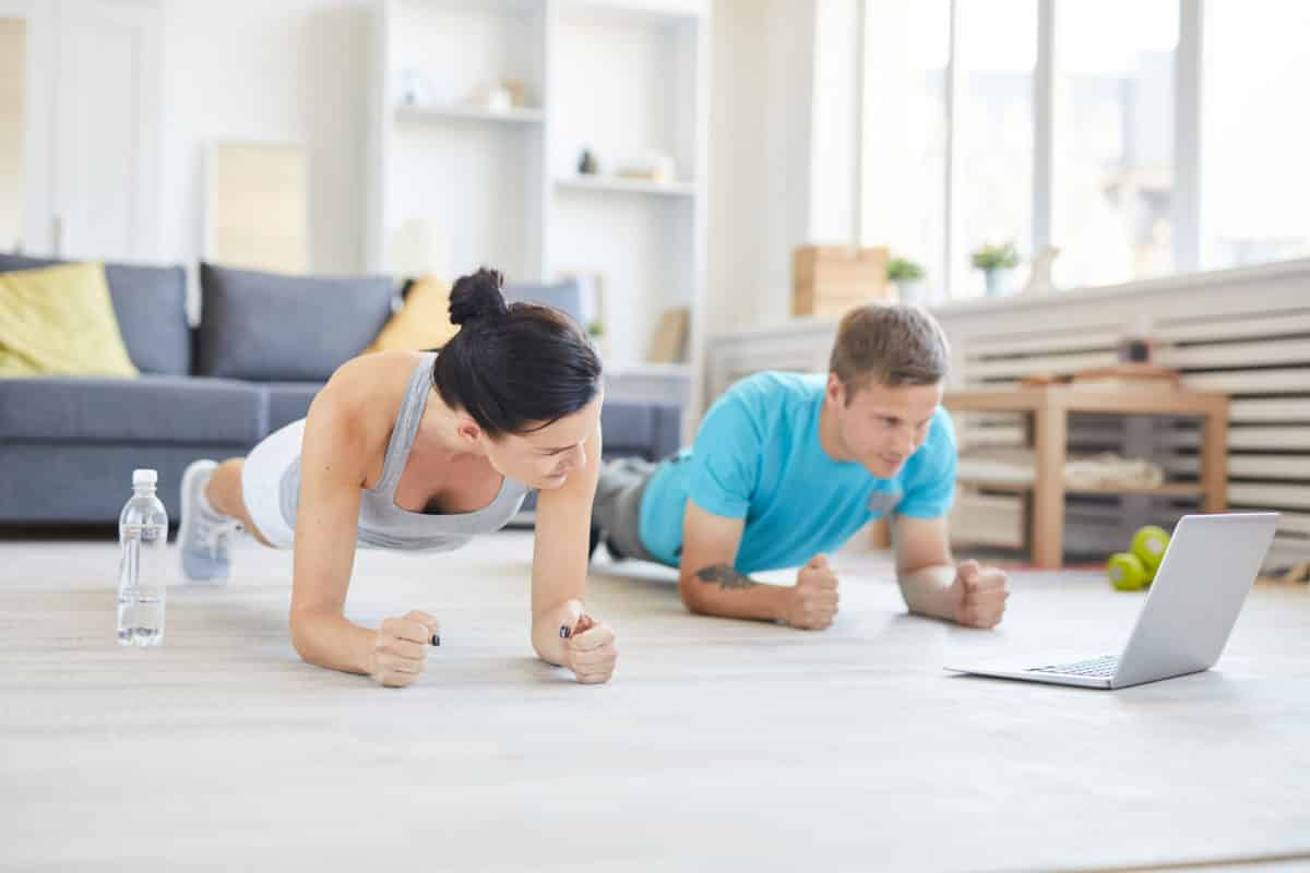 Two people working out at home