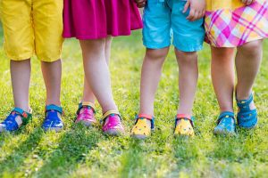 Children in bright shoes